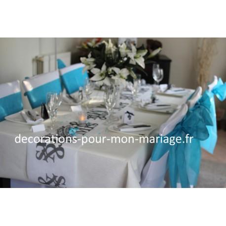 decorations housses de chaise et noeuds turquoises