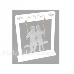 Couple mariés sur balançoire argent